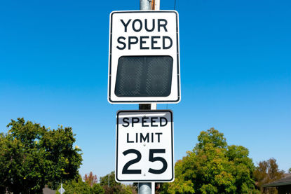 speed limit sign and speed indicator