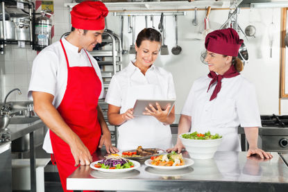 group of food service workers in kitchen