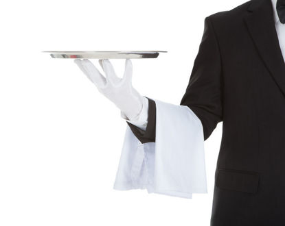 person in suit holding a tray