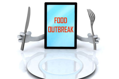 tablet with words food outbreak holding a knife and fork