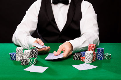hands of a dealer at a table