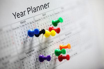calendar with numerous push pins