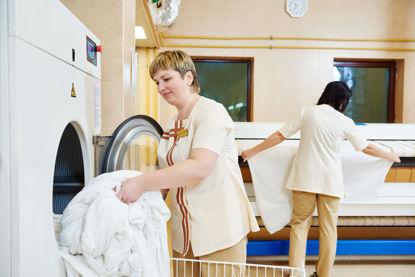 women working in laundry area