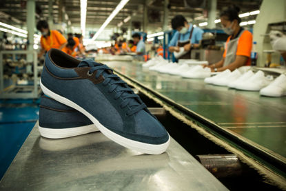 shoe with assembly line in the background