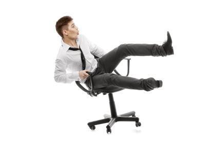 man falling out of office chair