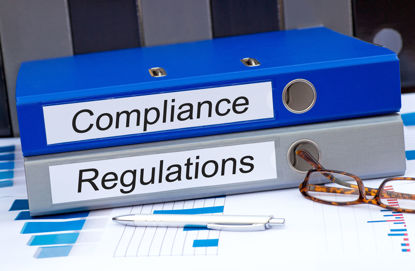 notebooks labeled compliance and regulations