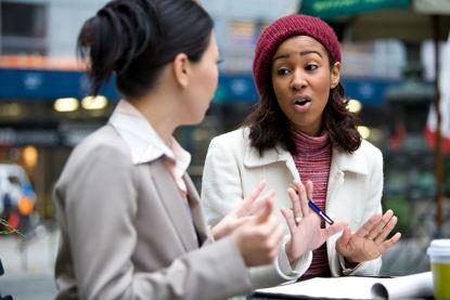 two women talking using gestures