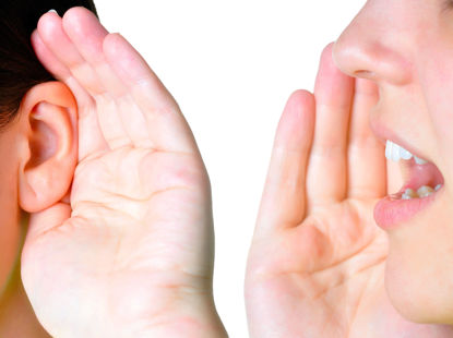 person's hand cupping an ear and another person's hand cupping a mouth