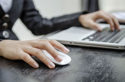 person's hand using a computer