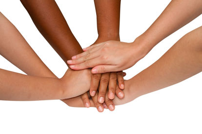 group of hands in a huddle