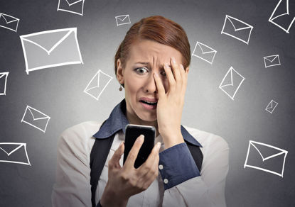 woman looking at cellphone with images of mail all around her