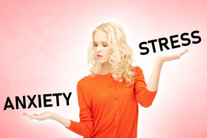 woman with hands like a scale and the word anxiety in one hand and the word stress in the other