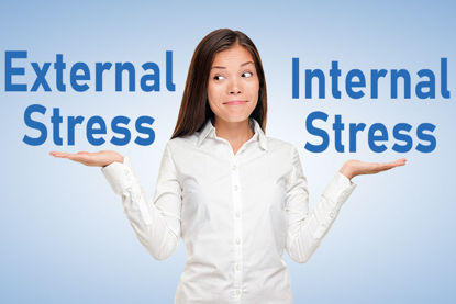 woman with hands like a scale and the words external stress in one hand and the words internal stress in the other