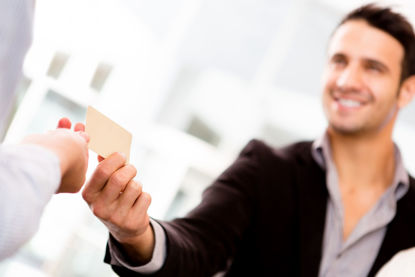 male with credit card making a purchase