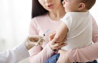 infant receiving a shot