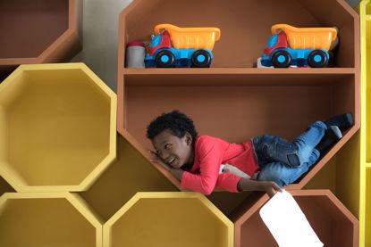 child in shelf