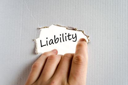word liability underneath ripped cardboard
