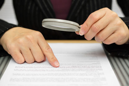person looking at paperwork