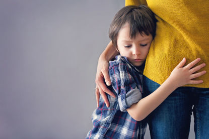 child clinging to an adult