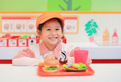 child playing in pretend restaurant
