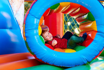 child playing on inflatable equipment
