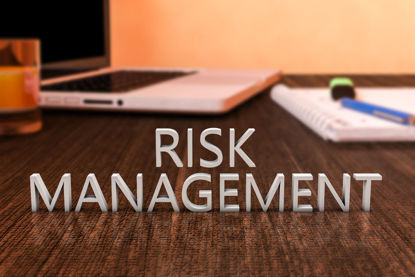 table with words risk management on it