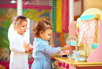 children at a toy kitchen