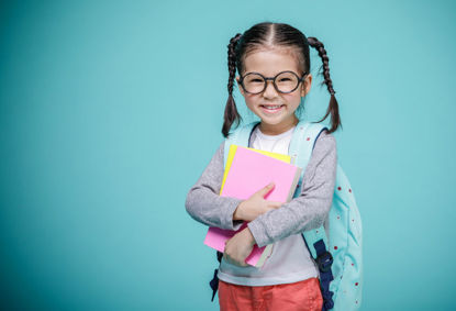 girl with backpack ready for school