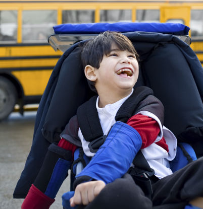happy child in wheelchair