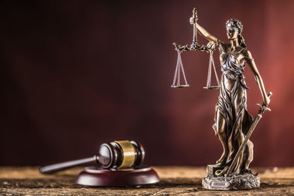 lady justice statue beside a gavel