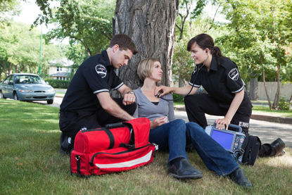 emergency personnel assisting a person
