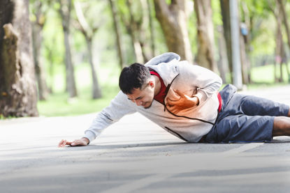 person on ground holding chest