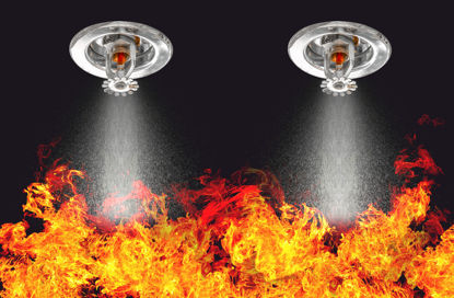fire sprinklers spraying fire