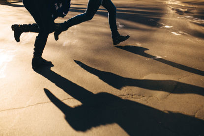 shadows of people running