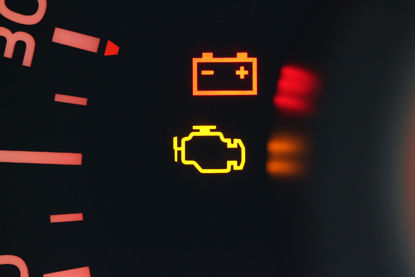 check engine and battery symbols lit up on dash