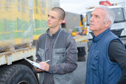 two men looking at trailer