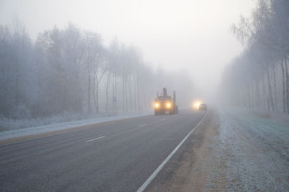 truck driving in foggy weather