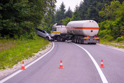 traffic cones blocking wreck between car and tanker truck