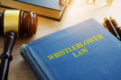 whistleblower law book and gavel