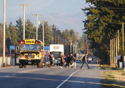 older children getting off bus