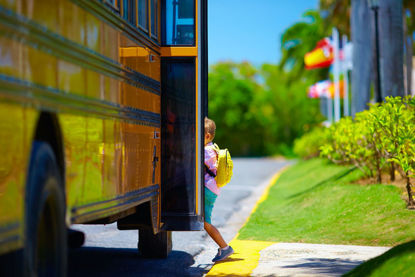 child stepping onto a bus