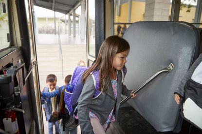 children boarding a school bus